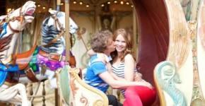 romantic couple in amusement park